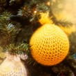 Knitted Christmas ball on  Christmas tree — Stock Photo