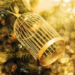 Golden Christmas decoration on  branches of fir tree — Stock Photo