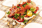 Roast suckling pig on banquet table — Stock Photo