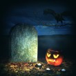 Halloween horror concept. Scary pumpkin in cemetery — Stock Photo