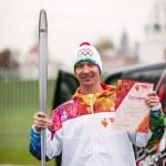 Aleksey Kolesnikov carrying Olympic torch, Kolomna, Russia — Stock Photo #33043673