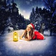 Stock Photo: Christmas card design - beautiful woman