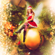 Fairy christmas woman on a decorative ball — Stock Photo