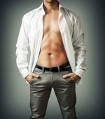 Portrait of muscle man torso in white shirt — Stock Photo
