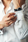 Sexy man buttons cuff-link on French cuffs — Stock Photo