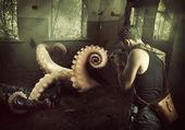 Military man shoots machine gun in octopus — Stock Photo