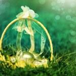 Basket of golden easter eggs on green grass — Stock Photo #41487267