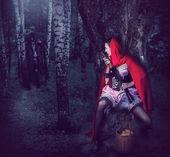 Girl Red Riding Hood with automatic — Stock Photo