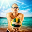 Young man playing volleyball on the beach — Stock Photo