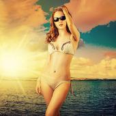 Beautiful woman sunbathing at the seaside  — Stock Photo