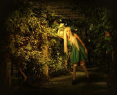 Young blond woman walking into enchanted forest.  — Stock Photo