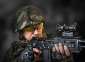 Sniper aiming a machine gun — Stock Photo