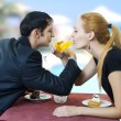Young happy amorous couple drink with white wine — Stock Photo #5178733