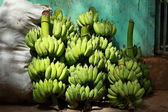 Green banana bunches in local bazaar in India. — Stock Photo
