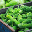Green paprica in traditional vegetable market in India. - Stock Photo