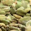 Green cardamom seeds. Aromatic spice.texture background — Stock Photo #16136991