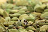 Green cardamom seeds. Aromatic spice.texture background — Stock Photo