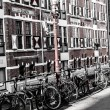Typical Amsterdam architecture with bikes — Stock Photo