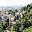 Bergamo, Citta Alta, Lombardy, Italy, from via San Vigilio on a sunny spring afternoon.Bergamo, Citta Alta, Lombardy, Italy, from via San Vigilio on a sunny spring afternoon. — Stock Photo #18488699