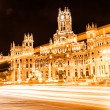 Rush of night time traffic at plaza de cibeles, madrid, spain — Stock Photo