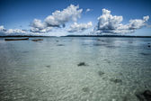 Transparent sea water and blue sky with clouds — Stock Photo
