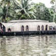 Stock Photo: House boat in backwaters near palms in Alappuzha, Kerala, India