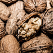 Walnuts in shells, one upon the other — Stockfoto