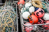 Lobster or crayfish pots stacked on fishing boat, close focus on centre pot, St Helens, Tasmania, Australia — Stock Photo