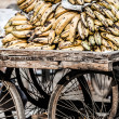Bananas in a wheelbarrow on a fruits and vegetable market, Nepal — Stock Photo #19102419