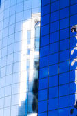 Blue sky reflected in the glass building. — Stock Photo