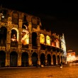 The Colosseum under the glow of lights at night, Rome — Stock Photo #19695397