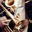 Vintage trombones playing in a big band. — Stock Photo