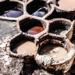 Old tanks of the Fez&#039;s tanneries with color paint for leather, Morocco, Africa - Stock Photo