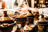 Selection of very colorful Moroccan tajines (traditional casserole dishes) — 图库照片