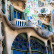 BARCELONA - April 13: The facade of the house Casa Battlo (also could the house of bones) designed by Antoni Gaudi with his famous expressionistic style on April 13, 2013 Barcelona, Spain - Stock Photo