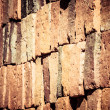 Vintage brick wall rusty colored abstract background. — Stock Photo