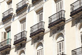Mediterranean architecture in Spain. Old apartment building in Madrid. — Stock Photo