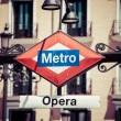 Metro Sign on blurred city, Madrid — Stock Photo