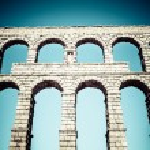 Ancient roman aqueduct of Segovia at Castile and Leon, Spain — Stock Photo