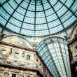 Glass dome of Galleria Vittorio Emanuele II shopping gallery. Milan, Italy. — Stock Photo