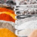 Indian colorful spices and tea at Anjuna flea market in Goa, India — Stock Photo #27816005