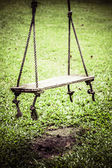 Swings on a playground — Stock Photo