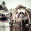 House boat in backwaters near palms in Alappuzha, Kerala, India — Stock Photo #28077951