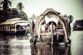 House boat in backwaters near palms in Alappuzha, Kerala, India — Stock Photo