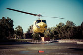 Fire rescue heavy helicopter with water bucket, goes to a fire. — Stock Photo