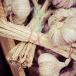 Close up of garlic on market stand — Stock Photo
