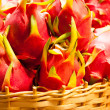Stockfoto: Dragon fruit on market stand, Thailand.