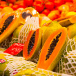Stock Photo: Sliced papayin basket at market
