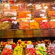 Market stall full of candys in La Boqueria Market. Barcelona. Catalonia. — Stock Photo