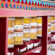 Stock Photo: Buddhist prayer wheels in Tibetmonastery with written mantra. India, Himalaya, Ladakh
